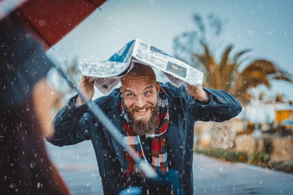 bearded and bald guy stuck in the rain