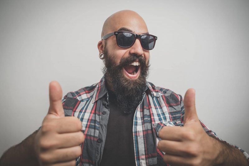 bald guy with a beard dressed casually