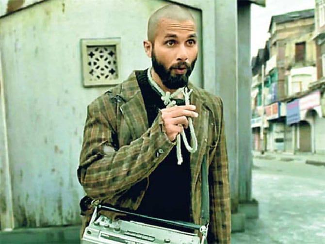 bald guy with unique fashion sense