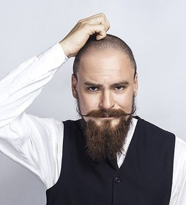 bald man with moustache and beard