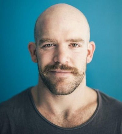 prominant-moustache-curly-man-bald