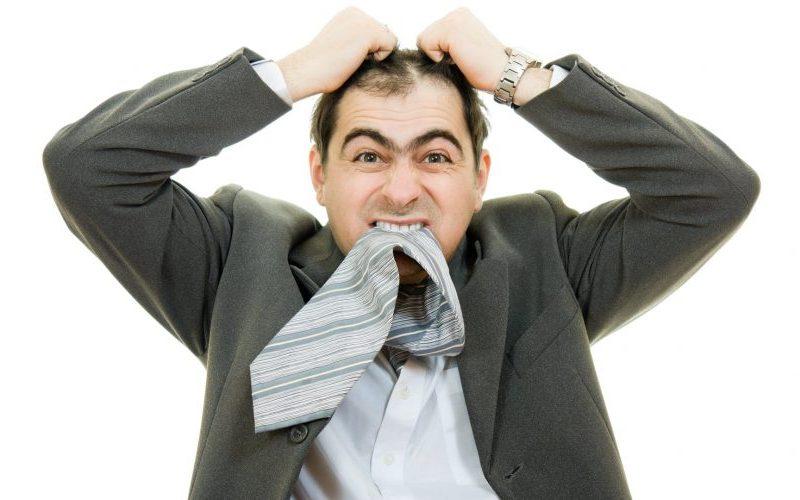 pulling-his-hair-out-stress-hair loss-bald-man-balding