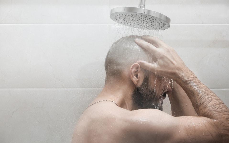 bald-guy-hair-loss-shower-products-shampoo